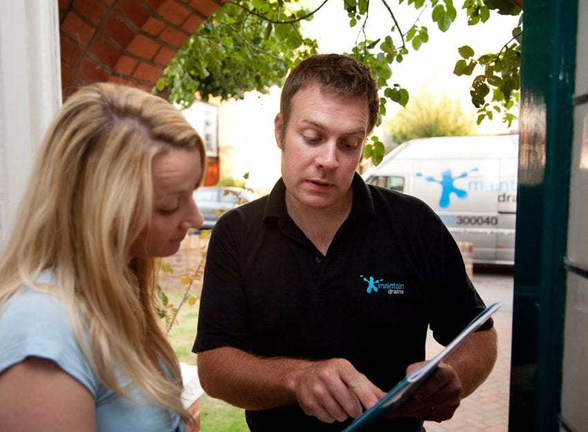 Maintain Drains drainage expert assisting a customer