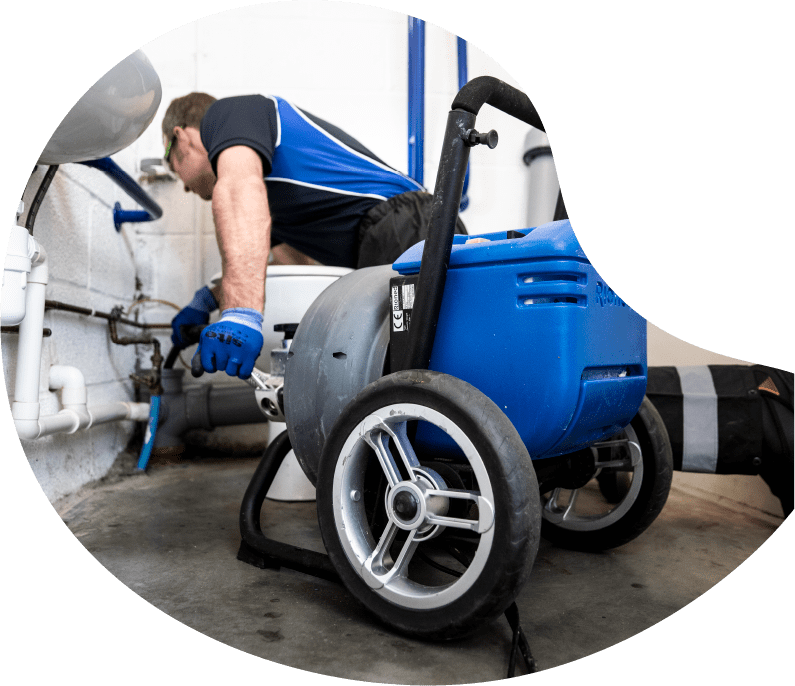 Maintain drains plumber conducting vacuum tanker services