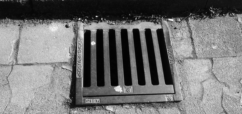 Outside drain on road next to pavement