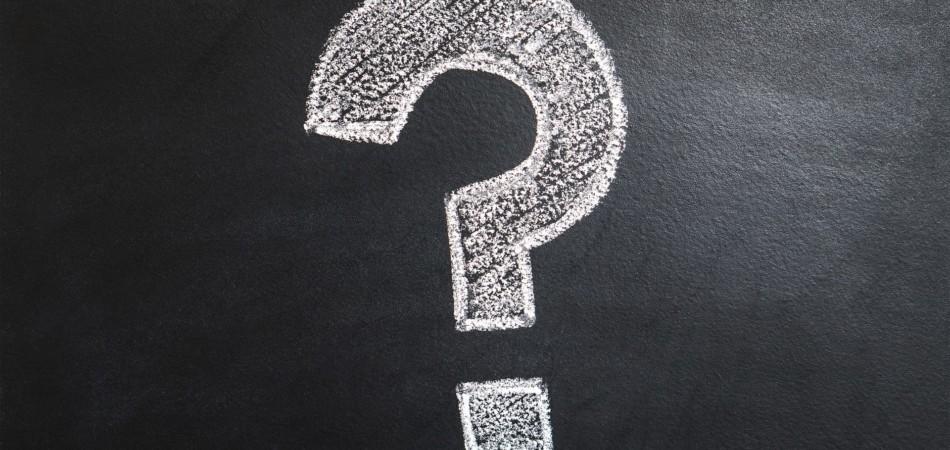 Question mark drawn on chalk board