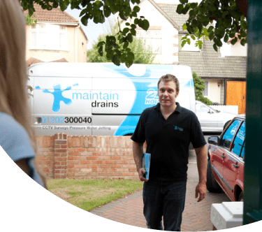 Maintain Drains plumber approaching customer's home