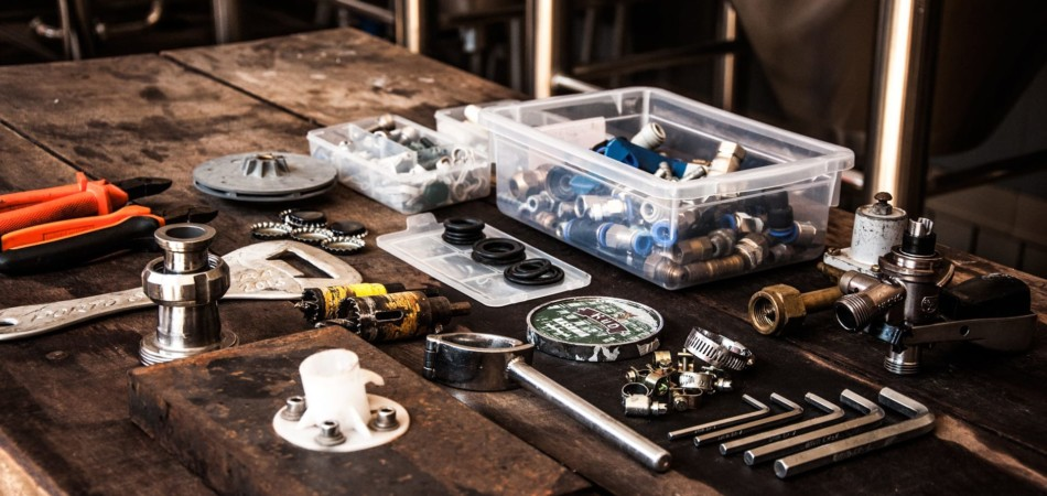 Professional plumbing tools and equipment laid out on table